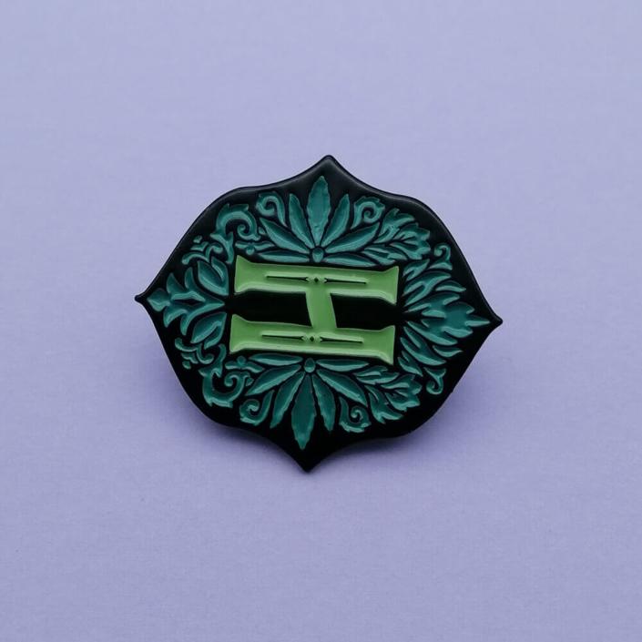 black dyed enamel pin